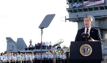 "US President George W. Bush addresses the nation aboard the nuclear aircraft carrier USS Abraham Lincoln 01 May, 2003, as it sails for Naval Air Station North Island, San Diego, California. Bush declared major fighting over in Iraq, calling it ""one victory in a war on terror"" which he said would continue until terrorists are defeated. ""In the Battle of Iraq, the United States and our allies have prevailed,"" Bush said. Bush touted Saddam Hussein's ouster as ""a crucial advance"" towards stamping out extremist violence.AFP Photo/Stephen JAFFE (Photo credit should read STEPHEN JAFFE/AFP/Getty Images)"