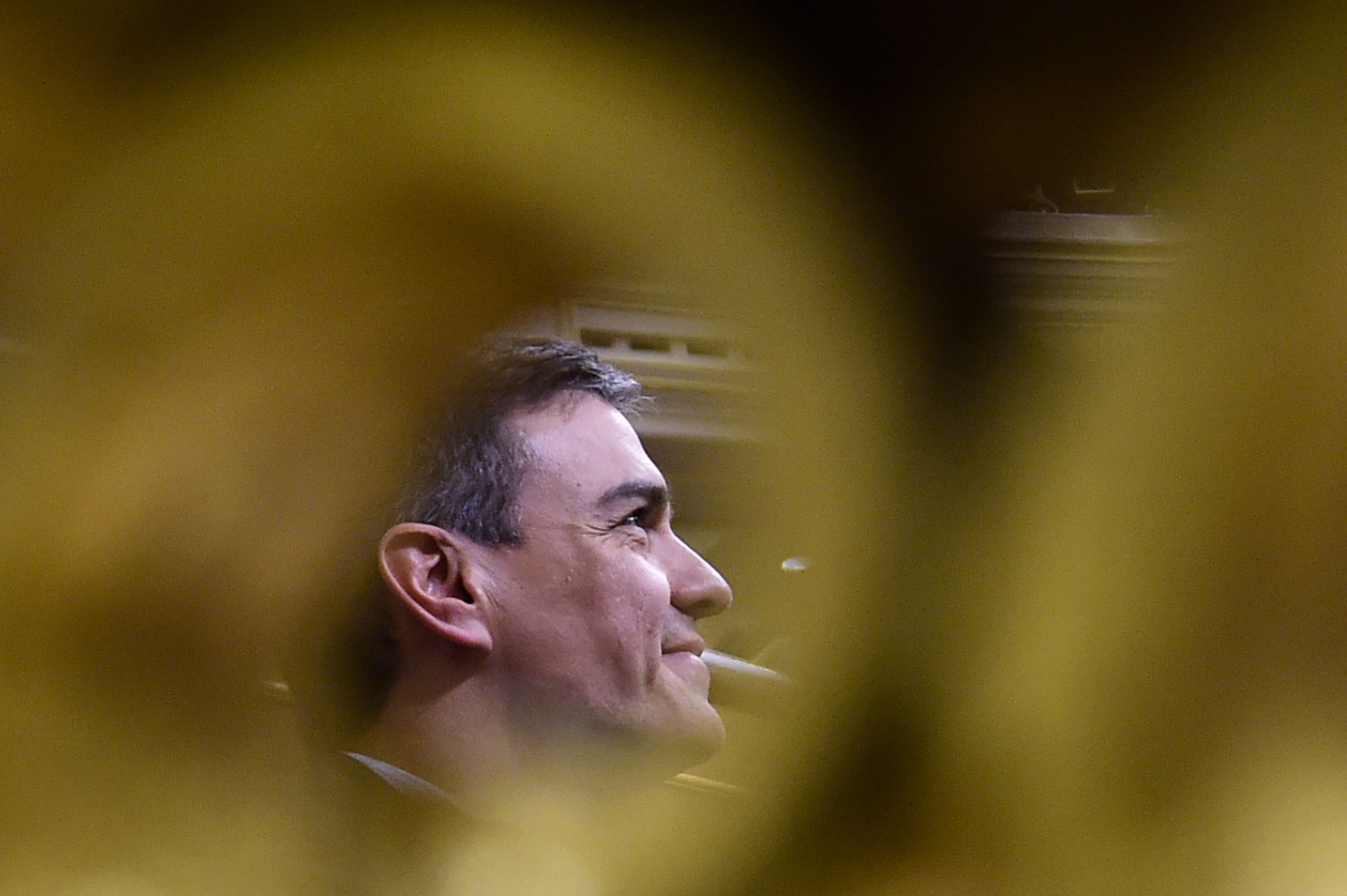 TOPSHOT - Leader of the Spanish Socialist Party PSOE, Pedro Sanchez attends a debate on a no-confidence motion at the Lower House of the Spanish Parliament in Madrid on June 01, 2018. - Bar any last-minute u-turn, an absolute majority of lawmakers as varied as Catalan separatists and Basque nationalists will vote the no-confidence motion filed last week by the Socialists over a string of corruption woes hitting Spanish Prime Minister Mariano Rajoy's conservative Popular Party (PP). (Photo by PIERRE-PHILIPPE MARCOU / AFP)        (Photo credit should read PIERRE-PHILIPPE MARCOU/AFP/Getty Images)
