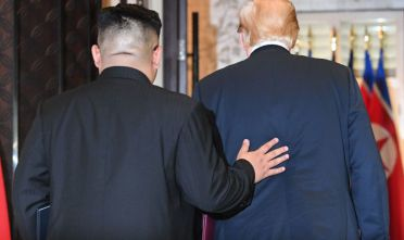 TOPSHOT - North Korea's leader Kim Jong Un (L) and US President Donald Trump leave following a signing ceremony during their historic US-North Korea summit, at the Capella Hotel on Sentosa island in Singapore on June 12, 2018. - Donald Trump and Kim Jong Un became on June 12 the first sitting US and North Korean leaders to meet, shake hands and negotiate to end a decades-old nuclear stand-off. (Photo by SAUL LOEB / AFP)        (Photo credit should read SAUL LOEB/AFP/Getty Images)