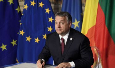 Hungary's prime Minister Viktor Orban signs the new Rome declaration with leaders of 27 European Union countries special during a summit of EU leaders to mark the 60th anniversary of the bloc's founding Treaty of Rome, on March 25, 2017 at Rome's Piazza del Campidoglio (Capitoline Hill).   Against a backdrop of crises and in the absence of the departing Britain, the leaders signed a new Rome declaration, six decades after the six founding members signed the Treaty of Rome and gave birth to the European Economic Community.  / AFP PHOTO / Tiziana FABI        (Photo credit should read TIZIANA FABI/AFP/Getty Images)