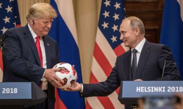 HELSINKI, FINLAND - JULY 16:  Russian President Vladimir Putin hands U.S. President Donald Trump (L) a World Cup football during a joint press conference after their summit on July 16, 2018 in Helsinki, Finland. The two leaders met one-on-one and discussed a range of issues including the 2016 U.S Election collusion.  (Photo by Chris McGrath/Getty Images)