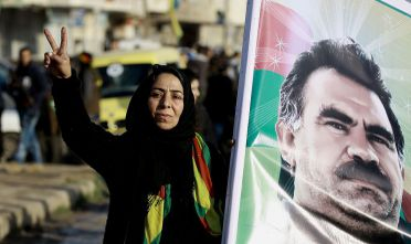 A Syrian Kurdish women holds a portrait of jailed Kurdish rebel chief Abdullah Ocalan during a rally denoucing that Kursdish reprensantatives were not invited to take part in the upcoming Astana peace talks, on January 16, 2017, in the northeastern city of Qamishli. The talks, beginning on January 23 in the Kazakh capital, are set to build on a nationwide truce that has largely held despite escalating violence across several battlefronts in recent days. Organised by rebel backer Turkey and regime allies Russia and Iran, the meetings are the latest bid to put an end to the brutal war raging in Syria since March 2011.  / AFP / DELIL SOULEIMAN        (Photo credit should read DELIL SOULEIMAN/AFP/Getty Images)
