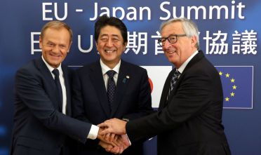 European Council President Donald Tusk (L), Japanese Prime Minister Shinzo Abe (C) and President of Commission  Jean-Claude Juncker pose for a picture at the European Council on July 6, 2017 in Brussels Japanese Prime Minister Shinzo Abe and the EU's top officials will join forces and approve the broad outline of a landmark trade deal that would challenge the protectionism championed by US President.  / AFP PHOTO / POOL / Francois Walschaerts        (Photo credit should read FRANCOIS WALSCHAERTS/AFP/Getty Images)