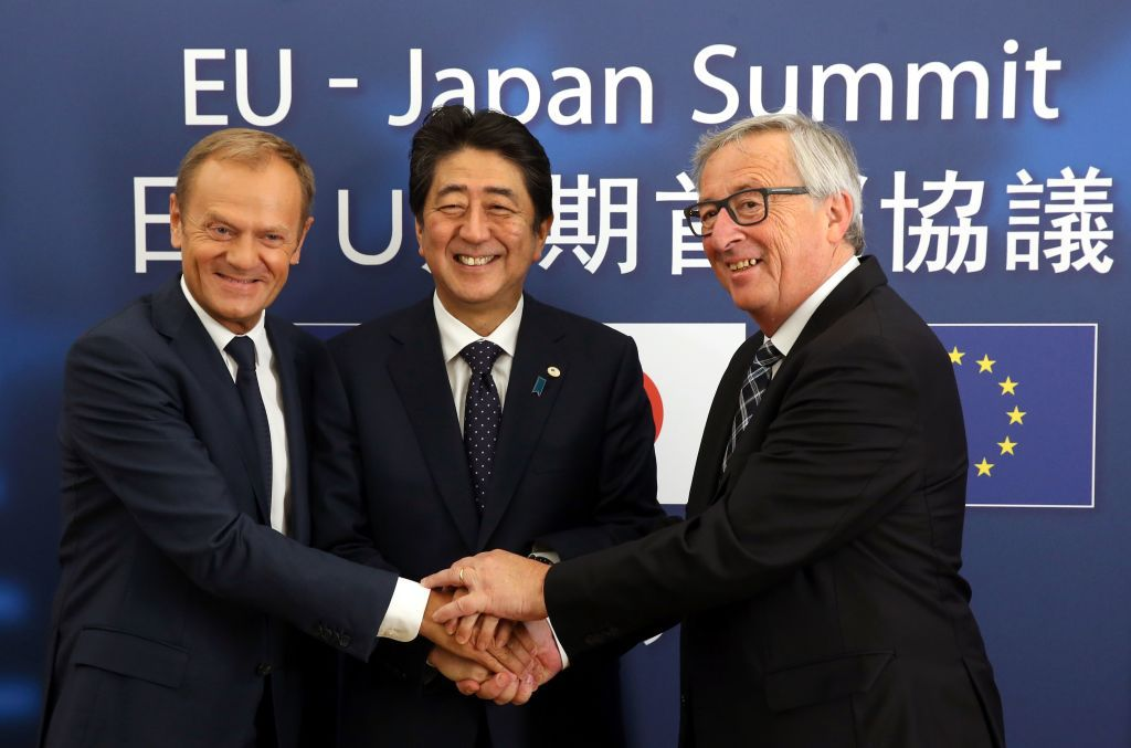 European Council President Donald Tusk (L), Japanese Prime Minister Shinzo Abe (C) and President of Commission 