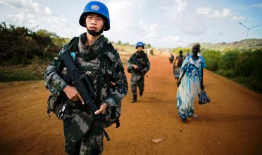 Peacekeeping troops from China, deployed by the United Nations Mission in South Sudan (UNMISS), patrol outside the premises of the UN Protection of Civilians (PoC) site in Juba on October 4, 2016.  According to the UN, due to the increase of sexual violence outside the PoC, UNMISS has intensified its patrols in and around the protection sites, as well as in the wider Juba city area, sometimes arranging special escorts for women and young girls. / AFP / ALBERT GONZALEZ FARRAN        (Photo credit should read ALBERT GONZALEZ FARRAN/AFP/Getty Images)