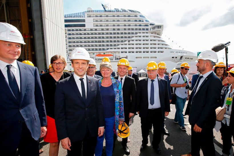 French Economy Minister Bruno Le Maire (L), French President Emmanuel Macron (2ndL), attend the delivery ceremony of the MSC Meraviglia cruise ship on May 31, 2017 at the STX shipyard of Saint-Nazaire, western France.   With a capacity of 65700 passengers and 1550 crew members, the MSC Meraviglia is the biggest cruise ship in Europe.  / AFP PHOTO / POOL / STEPHANE MAHE        (Photo credit should read STEPHANE MAHE/AFP/Getty Images)