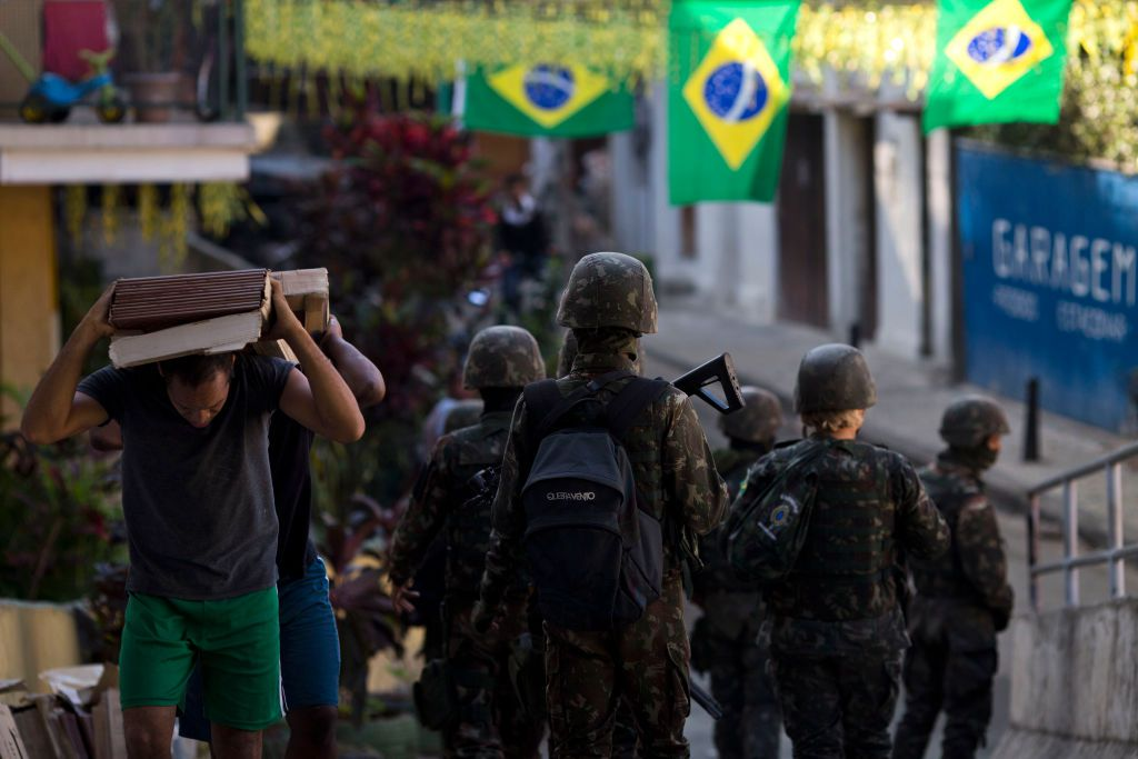 Members of the Brazil Armed Forces patrol during an operation inside the favelas of Chapeu-Mangueira and Babilonia at Leme neighbourhood, in Rio de Janeiro, Brazil, on June 21, 2018. - Seven people, including a boy of 14, have been killed in continuing violence between army-backed police units and Rio de Janeiro's criminal gangs, reports said Thursday. (Photo by Mauro Pimentel / AFP)        (Photo credit should read MAURO PIMENTEL/AFP/Getty Images)