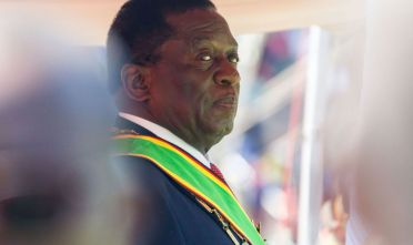 Emmerson Mnangagwa looks on during his official inauguration ceremony as the President of Zimbabwe at the National Sports Stadium in the capital Harare, on August 26, 2018. (Photo by Jekesai NJIKIZANA / AFP)        (Photo credit should read JEKESAI NJIKIZANA/AFP/Getty Images)