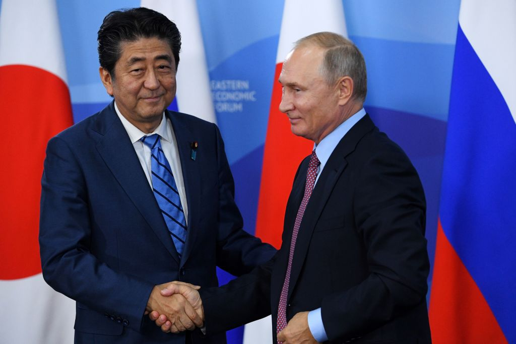Russian President Vladimir Putin (R) shakes hands with Japanese Prime Minister Shinzo Abe after a press conference following their meeting in Vladivostok on September 10, 2018. (Photo by Kirill KUDRYAVTSEV / AFP)        (Photo credit should read KIRILL KUDRYAVTSEV/AFP/Getty Images)