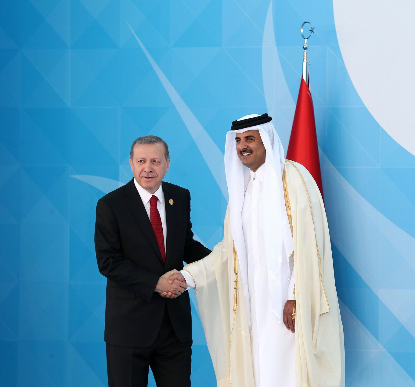 Turkish President Recep Tayyip Erdogan (L) shakes hands with Emir of Qatar, Sheikh Tamim bin Hamad Al Thani (R) during the 13th Organization of Islamic Cooperation (OIC) Summit at Istanbul Congress Center (ICC) on April 14, 2016 in Istanbul.  Erdogan on April 14 hosts over 30 heads of state and government from Islamic countries in Istanbul for a major summit aimed at overcoming differences in the Muslim world.  / AFP / POOL / ARIF HUDAVERDI YAMAN        (Photo credit should read ARIF HUDAVERDI YAMAN/AFP/Getty Images)