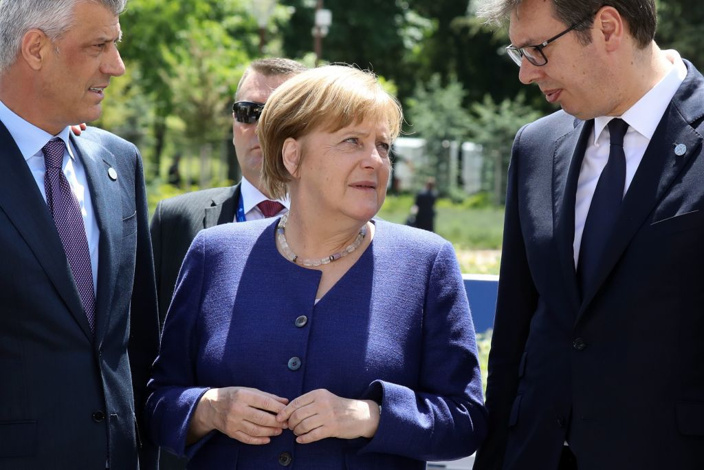 (From L) Kosovo's President Hashim Thaci , German Chancellor Angela Merkel and Serbian President Aleksandar Vucic speak together prior to the family photo during an EU-Western Balkans Summit in Sofia on May 17, 2018. - European Union leaders meet their Balkan counterparts to hold out the promise of closer links to counter Russian influence, while steering clear of openly offering them membership. (Photo by Ludovic MARIN / AFP)        (Photo credit should read LUDOVIC MARIN/AFP/Getty Images)