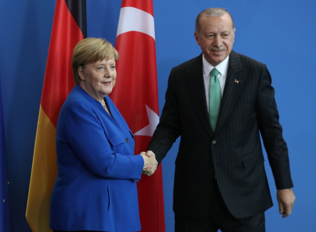 BERLIN, GERMANY - SEPTEMBER 28:  Turkish President Recep Tayyip Erdogan and German Chancellor Angela Merkel shake hands as they depart after speaking to the media at the Chancellery on September 28, 2018 in Berlin, Germany. President Erdogan is on the second of a three-day visit to Germany that includes meetings with German President Frank-Walter Steinmeier and Chancellor Angela Merkel in Berlin and the inauguration of a new mosque in Cologne. German-Turkish relations have been troubled over the last year following the arrest of German nationals in Turkey whom the Turkish government charges with supporting terrorism.  (Photo by Sean Gallup/Getty Images)