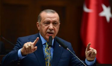 """ANKARA, TURKEY - OCTOBER 23: President Recep Tayyip Erdogan speaks about the murder of Saudi journalist Jamal Khashoggi during his weekly parliamentary address on October 23, 2018 in Ankara, Turkey. Erdogan said Khashoggi was the victim of a """"brutal"""" and """"planned"""" murder and called for the extradition of 18 suspects to Turkey to face justice. Khashoggi, a U.S. resident and critic of the Saudi regime, went missing after entering the Saudi Arabian consulate in Istanbul on October 2. (Photo by Getty Images)"""
