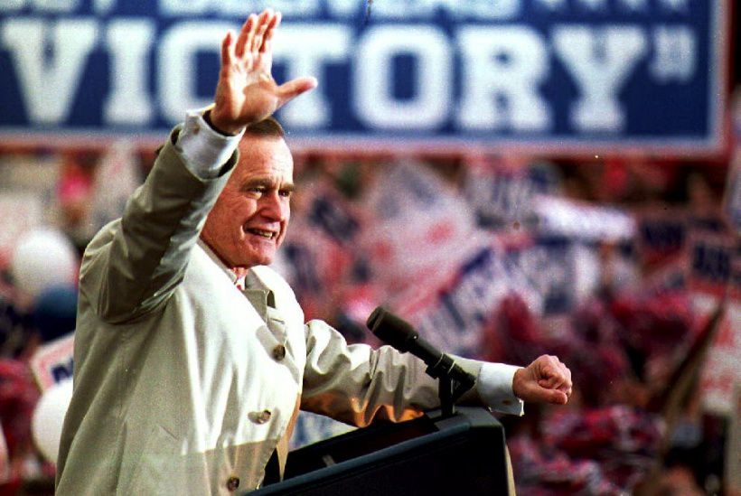 New Jersey: U.S. President George Bush waves to a group of supporters 02 November 1992 during a campaign stop at the Dodge Memorial Building. President Bush is trailing  Democratic candidate Bill Clinton in the polls.        (Photo credit should read J. DAVID AKE/AFP/Getty Images)