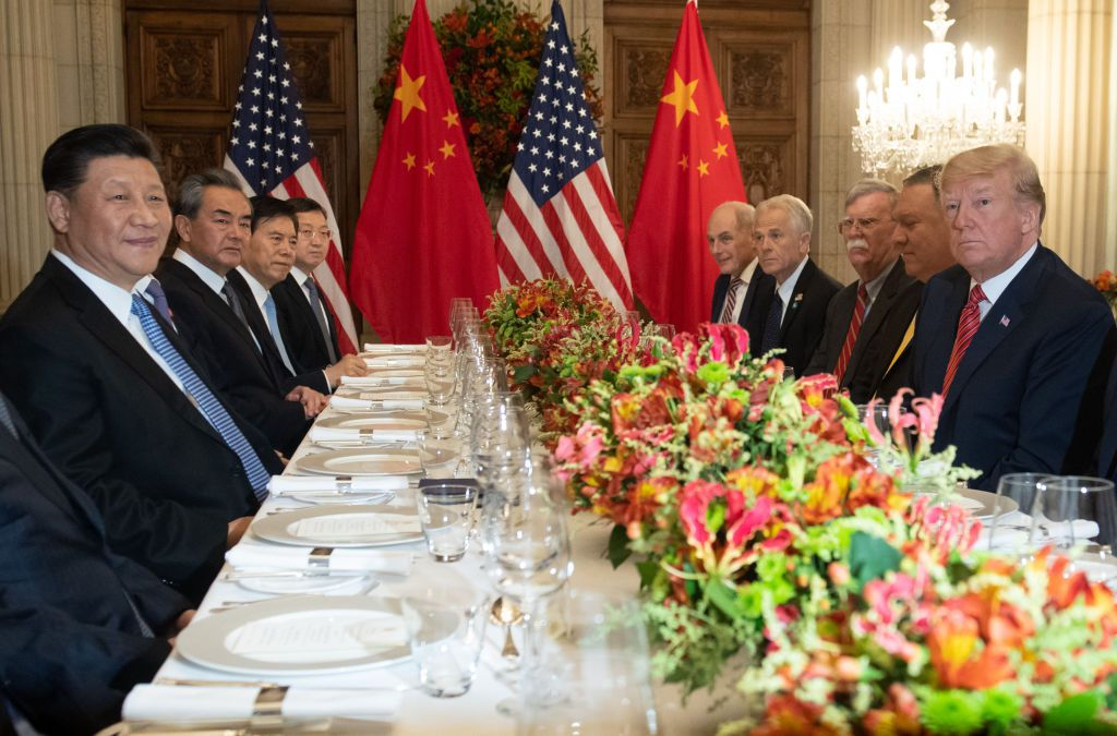 US President Donald Trump (R) US Secretary of State Mike Pompeo (2-R) and members of their delegation hold a dinner meeting with China's President Xi Jinping (L) Chinas Foreign Affairs Minister Wang Yi (2-L) and Chinese government representatives, at the end of the G20 Leaders' Summit in Buenos Aires, on December 01, 2018. - US President Donald Trump and his Chinese counterpart Xi Jinping had the future of their trade dispute -- and broader rivalry between the world's two top economies -- on the menu at a high-stakes dinner Saturday. (Photo by SAUL LOEB / AFP)        (Photo credit should read SAUL LOEB/AFP/Getty Images)