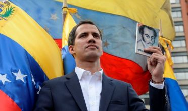 "Venezuela's National Assembly head Juan Guaido declares himself the country's ""acting president"" during a mass opposition rally against leader Nicolas Maduro, on the anniversary of a 1958 uprising that overthrew military dictatorship in Caracas on January 23, 2019. - Moments earlier, the loyalist-dominated Supreme Court ordered a criminal investigation of the opposition-controlled legislature. ""I swear to formally assume the national executive powers as acting president of Venezuela to end the usurpation, (install) a transitional government and hold free elections,"" said Guaido as thousands of supporters cheered. (Photo by Federico PARRA / AFP)        (Photo credit should read FEDERICO PARRA/AFP/Getty Images)"