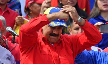 Venezuelan President Nicolas Maduro gestures during a gathering to mark the 20th anniversary of the rise of power of the late Hugo Chavez, the leftist firebrand who installed a socialist government, in Caracas on February 2, 2019. - Protesters flowed into the streets of Caracas Saturday, with flags and placards, many to support opposition leader Juan Guaido's calls for democratic elections and others to back embattled President Nicolas Maduro. (Photo by Yuri CORTEZ / AFP)        (Photo credit should read YURI CORTEZ/AFP/Getty Images)