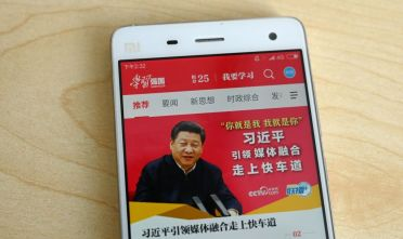"This photo illustratration taken on February 20, 2019 shows a phone app called ""Xuexi Qiangguo"" or ""Study to make China strong"" with an image of China's President Xi Jinping in Beijing. - A propaganda app that puts China's powerful President Xi Jinping in anyone's pockets has become a hit in the country -- with a helpful nudge from Communist Party officials. Xi, who could rule indefinitely after parliament lifted presidential term limits last year, has enjoyed a level of officially stoked adulation unseen since Communist China's founder Mao. (Photo by Greg Baker / AFP) / TO GO WITH China-politics-internet, FOCUS by Poornima WEERASEKARA        (Photo credit should read GREG BAKER/AFP/Getty Images)"