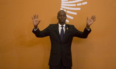 LIMA, PERU - APRIL 14: President of Haiti, Jovenel Moise greets the press during Day 2 of the VIII Summit of The Americas on April 14, 2018 in Lima, Peru. (Photo by Manuel Medir/Getty Images)