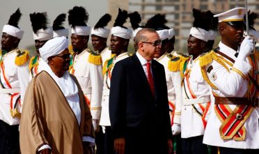 Turkish President Recep Tayyip Erdogan (C-R) is welcomed by his Sudanese counterpart Omar al-Bashir (C-L) upon his arrival in Khartoum on December 24, 2017, for a two-day-official visit. / AFP PHOTO / ASHRAF SHAZLY        (Photo credit should read ASHRAF SHAZLY/AFP/Getty Images)