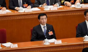Wang Huning (C), a member of the Standing Committee of the Political Bureau of the Communist Party of China (CPC) Central Committee, attends the opening session of the National People's Congress (NPC) at the Great Hall of the People in Beijing on March 5, 2019. (Photo by WANG ZHAO / AFP)        (Photo credit should read WANG ZHAO/AFP/Getty Images)