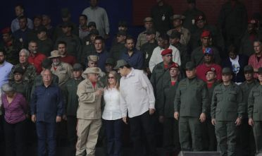 CARACAS, VENEZUELA - APRIL 13: Venezuela's President Nicolas Maduro speaks with Venezuela's National Constituent Assembly (ANC) President Diosdado Cabello during a military parade to commemorate the Day of the Bolivarian Militias, the Armed People and the April Revolution at Los Proceres on April 13, 2019 in Caracas, Venezuela. Civil militia were created by Hugo Chavez in 2002 during a so-called US backed coup attempt. While accusing the US of plotting an invasion to Venezuela, Nicol·s Maduro had announced a campaign to reach the number of million armed civilian volunteers to two million. (Photo by Marco Bello/Getty Images)