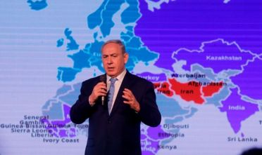 Israeli Prime Minister Benjamin Netanyahu delivers a speech on December 6, 2017 during a diplomatic conference organised by daily Israeli newspaper Jerusalem Post, in Jerusalem. President Donald Trump is set to recognise Jerusalem as Israel's capital, upending decades of careful US policy and ignoring dire warnings from Arab and Western allies alike of a historic misstep that could trigger a surge of violence in the Middle East.  / AFP PHOTO / Menahem KAHANA        (Photo credit should read MENAHEM KAHANA/AFP/Getty Images)