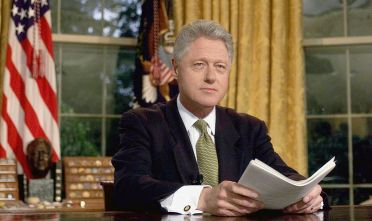 WASHINGTON, :  US President Bill Clinton poses for photographs after addressing the nation from the Oval Office in the White House 10 June, 1999, following the end of hostilities in Yugoslavia. President Clinton declared victory in NATO's war on Yugoslavia, but warned that air strikes would resume if Serb forces did not abide strictly to the pull out from Kosovo.   (ELECTRONIC IMAGE)  AFP  PHOTO  Joyce NALTCHAYAN (Photo credit should read JOYCE NALTCHAYAN/AFP/Getty Images)