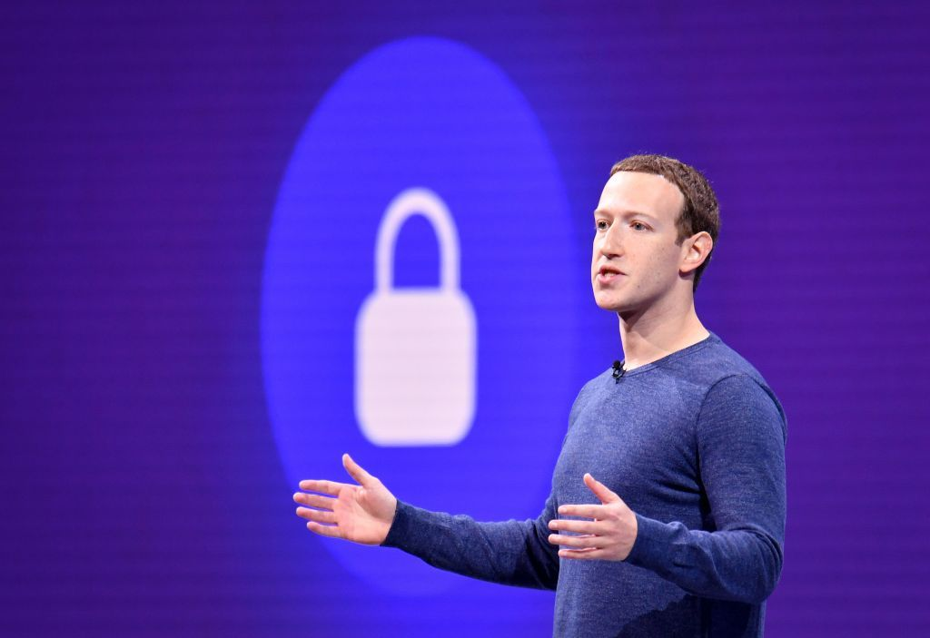 "(FILES) In this file photo taken on May 1, 2018 Facebook CEO Mark Zuckerberg speaks during the annual F8 summit at the San Jose McEnery Convention Center in San Jose, California. - Facebook is leaping into the world of cryptocurrency with its own digital money, designed to let people save, send or spend money as easily as firing off text messages.""Libra"" -- described as ""a new global currency"" -- was unveiled June 18, 2019 in a new initiative in payments for the world's biggest social network with the potential to bring crypto-money out of the shadows and into the mainstream. Facebook and an array of partners released a prototype of Libra as an open source code to be used by developers interested in weaving it into apps, services or businesses ahead of a rollout as global digital money next year. (Photo by JOSH EDELSON / AFP)        (Photo credit should read JOSH EDELSON/AFP/Getty Images)"