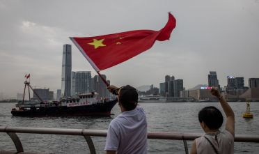 HONG KONG, HONG KONG - JULY 20: Pro- Beijing demonstrators wave the Chinese national flag at a ship during a rally in front of the Legislative Council Complex to show their support to the police on July 20, 2019 in Hong Kong, China. Pro-democracy protesters have continued weekly rallies on the streets of Hong Kong over the past month, calling for the complete withdrawal of a controversial extradition bill. Hong Kong's Chief Executive Carrie Lam has suspended the bill indefinitely, however protests have continued, with demonstrators now calling for her resignation. (Photo by Chris McGrath/Getty Images)