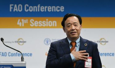 Newly-appointed FAO Director-General, China's Qu Dongyu acknowledges applause following the vote on June 23, 2019 during the FAO 41st Conference at the Food and Agriculture Organization of the United Nations (FAO) headquarters in Rome. (Photo by Vincenzo PINTO / AFP)        (Photo credit should read VINCENZO PINTO/AFP/Getty Images)