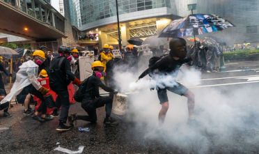 "HONG KONG - AUGUST 25: Protesters clash with police after a rally in Tsuen Wan on August 25, 2019 in Hong Kong, China. Pro-democracy protesters have continued rallies on the streets of Hong Kong against a controversial extradition bill since 9 June as the city plunged into crisis after waves of demonstrations and several violent clashes. Hong Kong's Chief Executive Carrie Lam apologized for introducing the bill and declared it ""dead"", however protesters have continued to draw large crowds with demands for Lam's resignation and completely withdraw the bill. (Photo by Billy H.C. Kwok/Getty Images)"