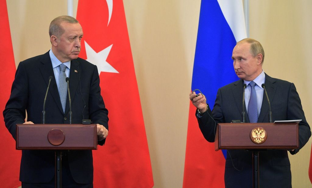Russian President Vladimir Putin (R) and his Turkish counterpart Recep Tayyip Erdogan  give a joint press conference following their talks in the Black sea resort of Sochi on October 22, 2019. (Photo by Alexey DRUZHININ / SPUTNIK / AFP) (Photo by ALEXEY DRUZHININ/SPUTNIK/AFP via Getty Images)
