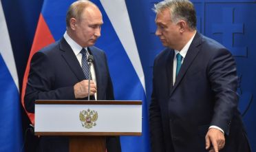 Hungarian Prime Minister Viktor Orban points the way to Russian President Vladimir Putin (L) after a press conference at the residence of the prime minister office in Budapest on October 30, 2019. - The Russian President is on brief visit to Hungary having talks with the Hungarian prime minister. (Photo by Attila KISBENEDEK / AFP) (Photo by ATTILA KISBENEDEK/AFP via Getty Images)