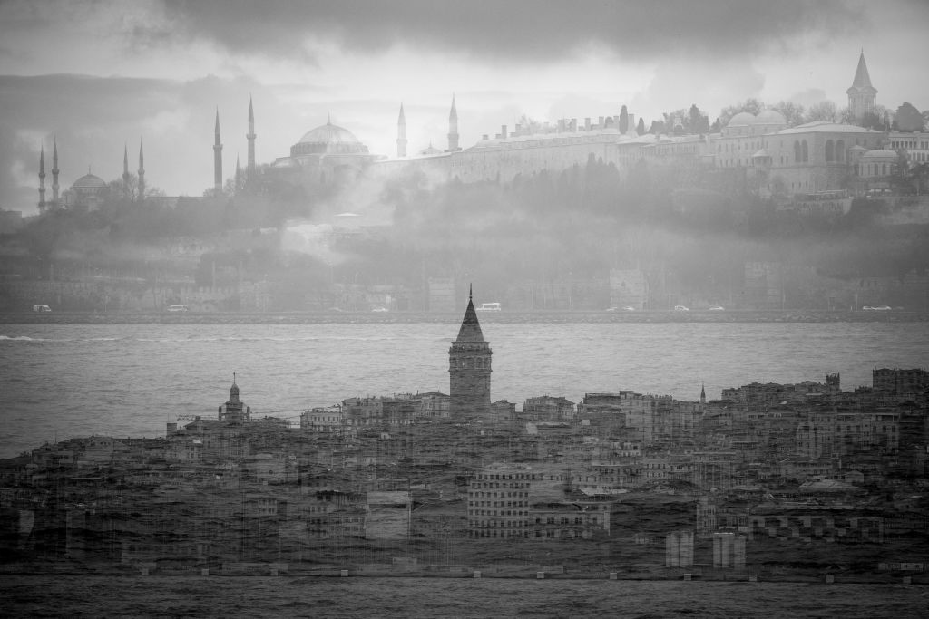 ISTANBUL, TURKEY - FEBRUARY 19:  (EDITORS NOTE: Multiple exposures were combined in camera to produce this image, the image has been shot in black and white. Color version not available.) The skyline showing Galata tower (bottom) overlayed the skyline of the Blue Mosque and Hagia Sofia on February 19, 2018 in Istanbul, Turkey. With Turkey being just days away from the most important elections in its modern history Presidential candidates from all parties are holding campaign rallies across Turkey ahead of the June 24, parliamentary and presidential elections.  Opposition parties have called the election a choice between democracy and one-man rule and  see the election as a point of no return. If Turkey's president Recep Tayyip Erdogan is re-elected, the parliamentary system would be replaced by an executive presidency, decided in last years referendum, it would also allow Erdogan to stay in power until 2023. The political uncertainty and the countries slow recovery after two years of instability due to terrorist attacks, diplomatic rows, declining tourism and now an economic crisis, leave many voters looking toward an uncertain future.  (Photo by Chris McGrath/Getty Images)