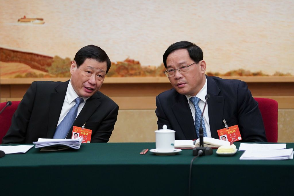 BEIJING, CHINA - MARCH 06:  Li Qiang, (R) the secretary of the Shanghai Municipal Committee of the Communist Party of China (CPC) talk with Shanghai Mayor Ying Yong (L) during the Shanghai delegation's group meeting during the annual National People's Congress at the Great Hall of the People on March 6, 2019 in Beijing, China.  (Photo by Lintao Zhang/Getty Images)