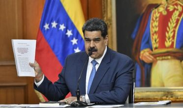 """Nicolas Maduro, Venezuela's president, holds documents while speaking during a press conference at Miraflores Palace in Caracas, Venezuela, on Friday, Feb. 14, 2020. """"The day the courts of the Republic orderJuan Guaido's detention for the crimes he has committed, he will go to jail, rest assured,"""" Madurosaid. Photographer: Carlos Becerra/Bloomberg via Getty Images"""
