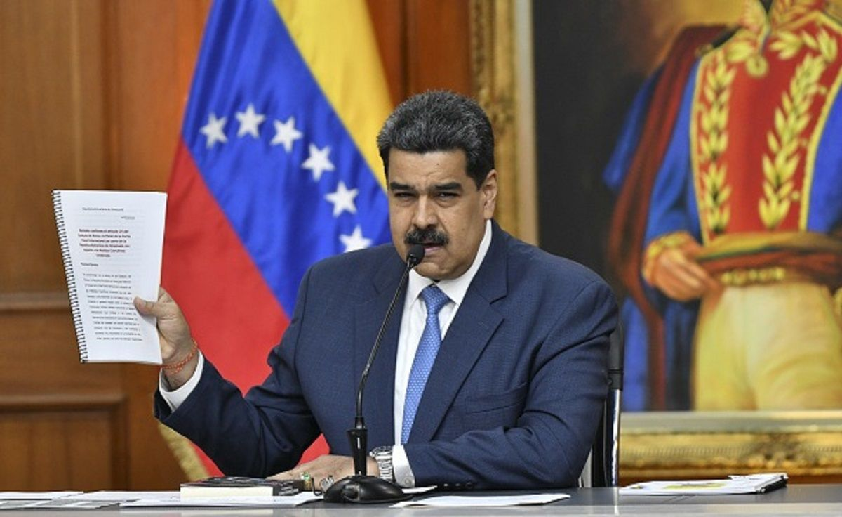 "Nicolas Maduro, Venezuela's president, holds documents while speaking during a press conference at Miraflores Palace in Caracas, Venezuela, on Friday, Feb. 14, 2020. ""The day the courts of the Republic order Juan Guaido's detention for the crimes he has committed, he will go to jail, rest assured,"" Maduro said. Photographer: Carlos Becerra/Bloomberg via Getty Images"