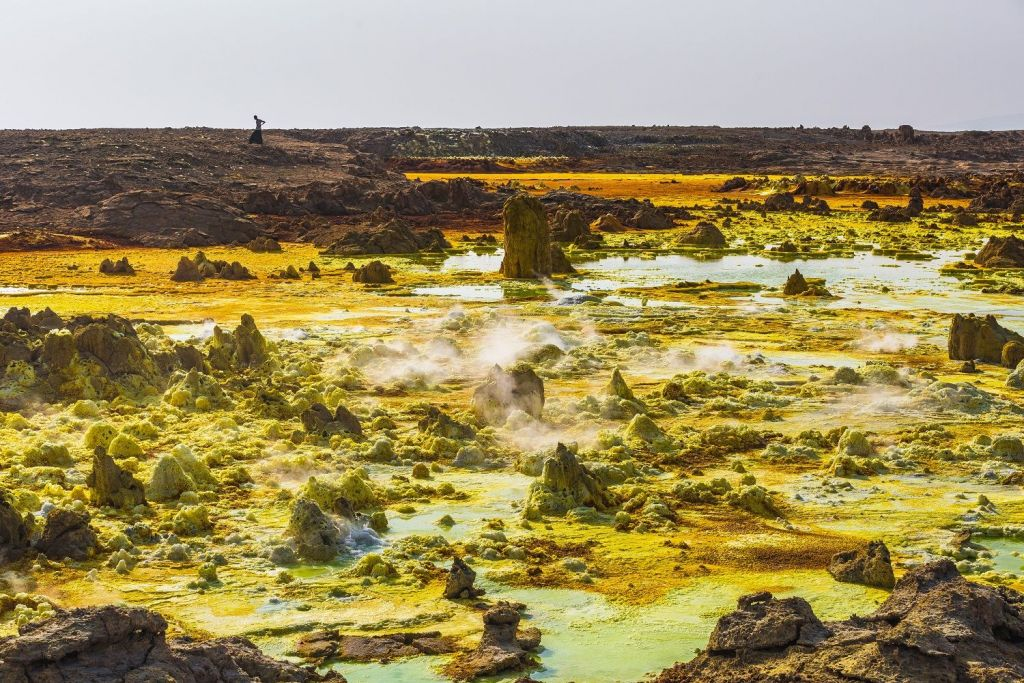 *** EXCLUSIVE *** AFAR, ETHIOPIA - OCTOBER 2015: Dallol, a landscape of multi-colored hot springs and bizarre formations, in Afar, Ethiopia. Welcome to the Gateway to Hell - where salt miners dig out the white gold in one of the hottest and harshest environments in the world. For centuries Ethiopians have made the long trek to the Danakil Depression to collect salt from the sun-blasted earth before transporting the slabs back by camel. Parts of the region are more than 300 feet below sea level, forming a cauldron where temperatures reach above 120 degrees Fahrenheit in the summer and active volcanoes roil. PHOTOGRAPH BY Massimo Rumi / Barcroft Media UK Office, London. T +44 845 370 2233 W www.barcroftmedia.com USA Office, New York City. T +1 212 796 2458 W www.barcroftusa.com Indian Office, Delhi. T +91 11 4053 2429 W www.barcroftindia.com (Photo credit should read Massimo Rumi / Barcroft Media / Barcroft Media via Getty Images)