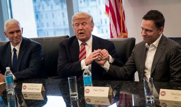 NEW YORK, NY - DECEMBER 14: (L to R) Vice President-elect Mike Pence looks on as President-elect Donald Trump shakes the hand of Peter Thiel during a meeting with technology executives at Trump Tower, December 14, 2016 in New York City. This is the first major meeting between President-elect Trump and technology industry leaders. (Photo by Drew Angerer/Getty Images)