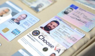 "CARACAS, VENEZUELA - MAY 4: (----EDITORIAL USE ONLY â MANDATORY CREDIT - "" MIRAFLORES PRESIDENTIAL PALACE"" - NO MARKETING NO ADVERTISING CAMPAIGNS - DISTRIBUTED AS A SERVICE TO CLIENTS----) ID cards of people linked to an operation denounced by Venezuelan President Nicolas Maduro are displayed during a meeting with members of the Armed Forces in Caracas, Venezuela on May 4, 2020. Venezuela's President Nicolas Maduro confirmed the detention of two US ""mercenaries"" among 13 attackers involved in Sunday's two failed maritime raids. ""In this group were members of Donald Trump's security team: Airan Berry, a professional mercenary of the United States, and Luke Denman. They are already declaring,"" Maduro said in a televised speech late Monday regarding the second foiled ""terrorist actions"" against his government. (Photo by Miraflores Presidential Palace/Anadolu Agency via Getty Images)"