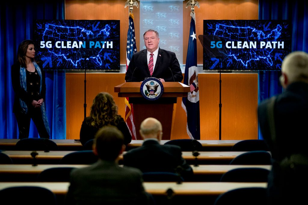Screens that read 5G Clean Path with a map of the United States are visible behind Secretary of State Mike Pompeo, accompanied by State Department spokeswoman Morgan Ortagus(L), as he speaks at a news conference at the State Department on April 29, 2020, in Washington,DC. (Photo by Andrew Harnik / POOL / AFP) (Photo by ANDREW HARNIK/POOL/AFP via Getty Images)