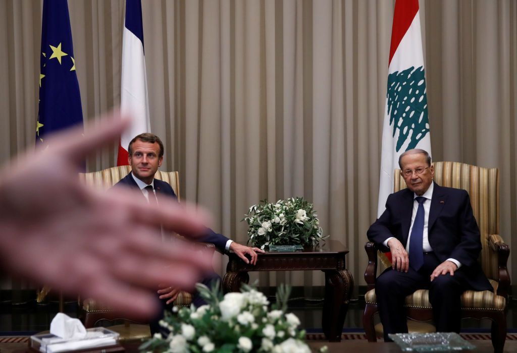 Lebanese President Michel Aoun welcomes French President Emmanuel Macron at Beirut International airport on August 31, 2020. - Macron arrived in Beirut for his second visit since a deadly explosion on August 4 shook the nation and fuelled a drive for political change. Macron, who first flew to Beirut only two days after the blast, arrived at 9 pm (1800 GMT) for a two-day visit that will include a ceremony marking the centenary of Greater Lebanon. (Photo by GONZALO FUENTES / POOL / AFP) (Photo by GONZALO FUENTES/POOL/AFP via Getty Images)