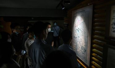 This photo taken on June 17, 2020 shows people looking at a map of the Korean peninsula during a visit to the Chinese People's Volunteer Army Commemorative Museum in Shanghai. - It is 70 years since Chinese and US forces engaged in brutal combat on opposite sides of the Korean War, but now tensions are rising again between the nuclear-armed super powers. (Photo by Hector RETAMAL / AFP) / TO GO WITH SKorea-NKorea-China-US-war-anniversary-diplomacy,FOCUS by Peter Stebbings (Photo by HECTOR RETAMAL/AFP via Getty Images)