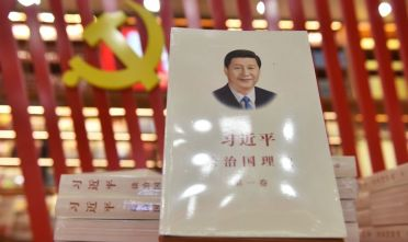 "A book about Chinese President Xi Jinping entitled ""The Governance of China"" is seen on display at a bookstore in Beijing on February 28, 2018. President Xi Jinping's leap toward lifelong rule has largely been met by guarded silence in world capitals as governments try to predict how China's formidable leader will wield his newfound power on the global stage. The Communist Party's move to lift presidential term limits will allow Xi to reign supreme as he pushes through an ambitious agenda to turn China into a military and economic superpower by mid-century. / AFP PHOTO / GREG BAKER        (Photo credit should read GREG BAKER/AFP via Getty Images)"