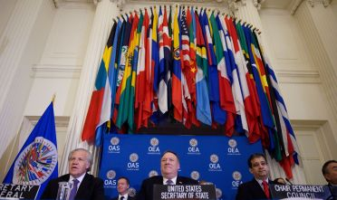US Secretary of State Mike Pompeo (C) sits with Organization of American States Secretary General Luis Almagro (L) and Minister-Counselor Riyad Insanally, at the OAS during a gathering of the representatives in Washington, DC on January 17, 2020. (Photo by ANDREW CABALLERO-REYNOLDS / AFP) (Photo by ANDREW CABALLERO-REYNOLDS/AFP via Getty Images)