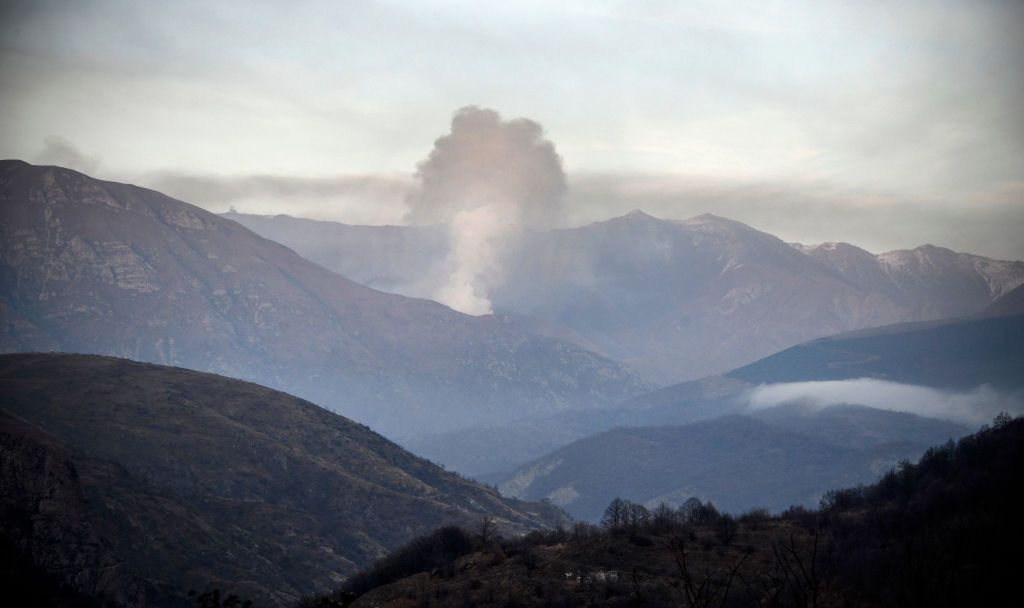 Smoke rises from a village  outside the town of Kalbajar, on November 14, 2020, after a peace agreement was signed to end the military conflict between Armenia and Azerbaijan over the disputed Nagorno-Karabakh region. - Villagers outside of Nagorno-Karabakh set their homes on fire on November 11 before fleeing to Armenia ahead of a weekend deadline that will see some disputed territory handed over to Azerbaijan as part of a peace agreement. Residents of the Kalbajar district in Azerbaijan, which has been controlled by Armenian separatists for decades, began a mass exodus this week after it was announced that Azerbaijan would regain control on November 11. (Photo by Alexander NEMENOV / AFP) (Photo by ALEXANDER NEMENOV/AFP via Getty Images)