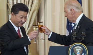US Vice President Joe Biden and Chinese President Xi Jinping toast during a State Luncheon for China hosted by US Secretary of State John Kerry on September 25, 2015 at the Department of State in Washington, DC.              AFP PHOTO/PAUL J. RICHARDS        (Photo credit should read PAUL J. RICHARDS/AFP via Getty Images)
