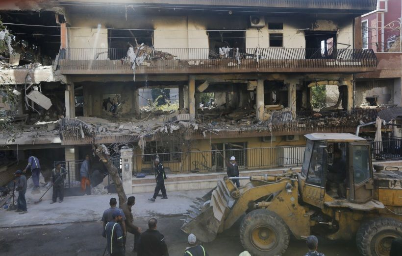 TOPSHOT - A picture taken on November 12, 2019, shows Syrian municipality workers clearing debris from building in Damascus' Mazze neighbourhood following an air strike. - Syrian state media reported that an Israeli strike hit the home of another Islamic Jihad militant, killing his son and another person. Israel did not immediately comment on that strike. Israel's military killed a commander of Palestinian militant group Islamic Jihad in a strike on his home in the Gaza Strip early, prompting retaliatory rocket fire and fears of a severe escalation in violence. (Photo by LOUAI BESHARA / AFP) (Photo by LOUAI BESHARA/AFP via Getty Images)