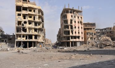 A general view shows damaged buildings in the eastern Syrian city of Deir Ezzor on November 4, 2017. Syrian and allied forces converged on holdout Islamic State group fighters in the Syrian border town of Albu Kamal, the jihadists' very last urban bastion following a string of losses. On November 3, Russian-backed Syrian regime forces took full control of Deir Ezzor, which was the last city where IS still had a presence after being expelled from Hawija and Raqa last month  / AFP PHOTO / STRINGER        (Photo credit should read STRINGER/AFP via Getty Images)